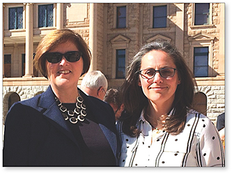 Figure 1. (right to left) Annette Hanian, OD, and Carol Alexander, OD, outside of the Arizona State Capitol in Phoenix.